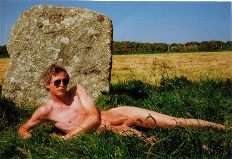 guy laying in field